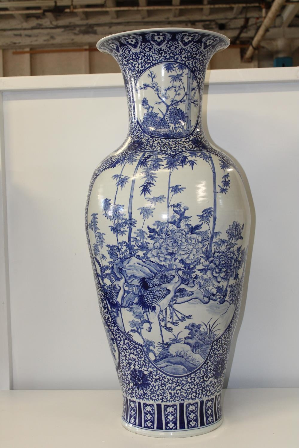 A very large & heavy floor standing blue & white Chinese vase Height 1.10 Meters x 43cm at widest