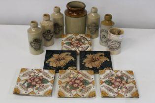 A selection of antique stoneware bottles & tiles
