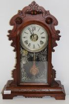 An antique American Ginger Bread striking mantel clock in GWO. Height 51cm x 36cm wide
