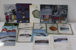 A job lot of London auction house catalogues relating to antique armour & militaria etc 15 in total