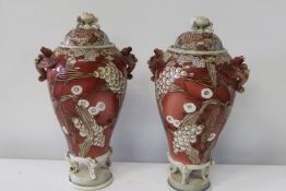 A pair of large lidded ewers with pheonix handles. One has bad repairs to the lid. Sold as seen