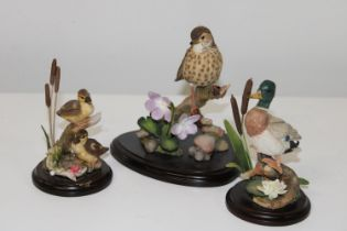 Three hand decorated 'Country Artists' figurines