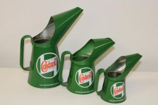 A set of three graduated reproduction Castrol oil cans