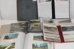 A selection of full postcard albums and one empty vintage album