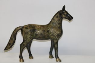A large metal ware horse figure 44x40cm