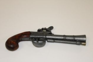 A replica flintlock pistol