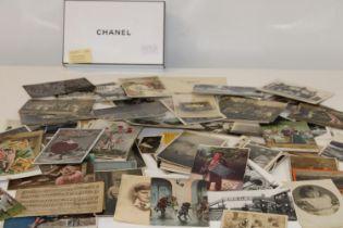 A box of vintage postcards, photo's & other ephemera