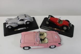 Three assorted collectable car models