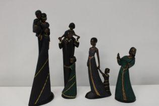 A group of four 'Mahogany Princess' figurines
