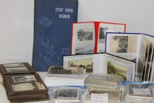 A large collection of vintage postcards and one empty vintage album