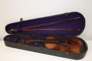 A Stainer violin & two bows in a coffin case with paper label inside which reads ' Jacubus