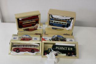 Four boxed Corgi bus models
