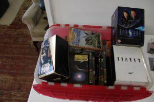 A box of Star Trek DVD's & other