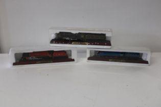 Three boxed locomotive models