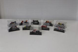 Ten boxed die-cast motorbike racing models