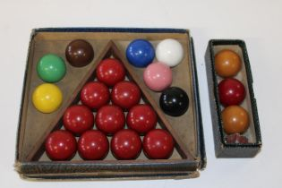 A boxed set of vintage snooker & billiard balls.