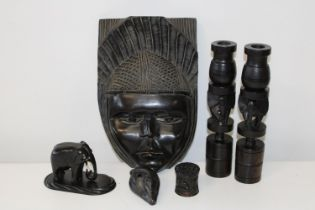 A good selection of carved African items. mask 34cm h