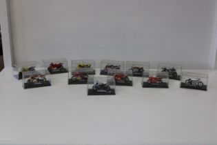 Twelve boxed die-cast motorbike models