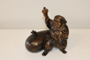 A Chinese bronzed figurine of a man with sack & mouse. 25cm x 25cm