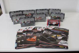 Nine boxed F1 die-cast models