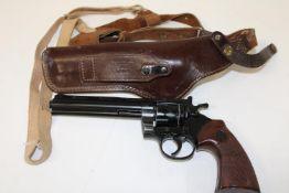 A replica gun & leather shoulder holster
