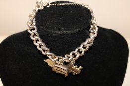 A heavy hallmarked silver bracelet & silver charms