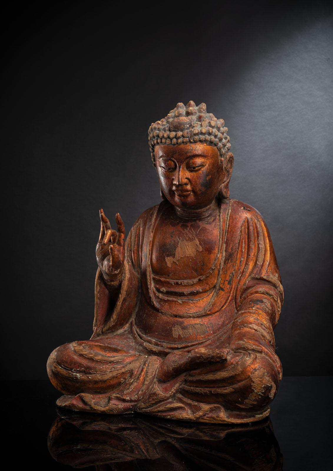 A GILT-LACQUERED CARVED WOOD FIGURE OF SEATED BUDDHA SHAKYAMUNI