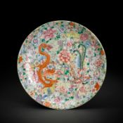 A LARGE MILLE-FLEUR GROUND FAMILLE ROSE DRAGON AND PHOENIX PLATE