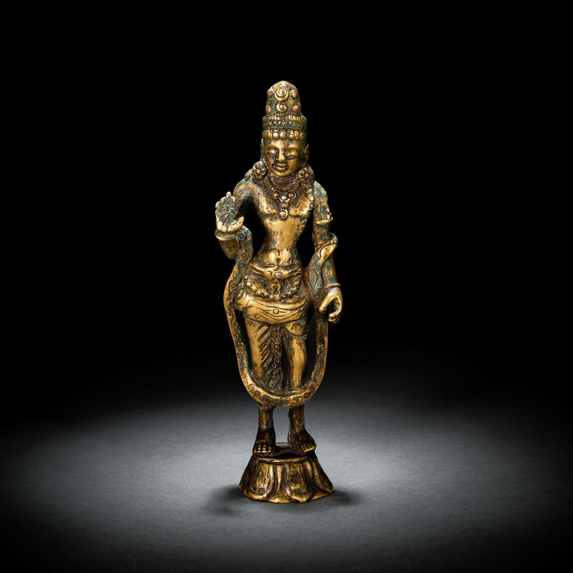 A BRONZE FIGURE OF A BODHISATTVA WITH SILVER AND COPPER INLAYS