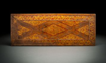 A GILT AND POLYCHROME MANUSCRIPT COVER FROM WOOD WITH LOYENGE MOTIF AND TENDRILS