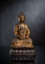 A LARGE PART-GILT BRONZE FIGURE OF SEATED BUDDHA SHAKYAMUNI
