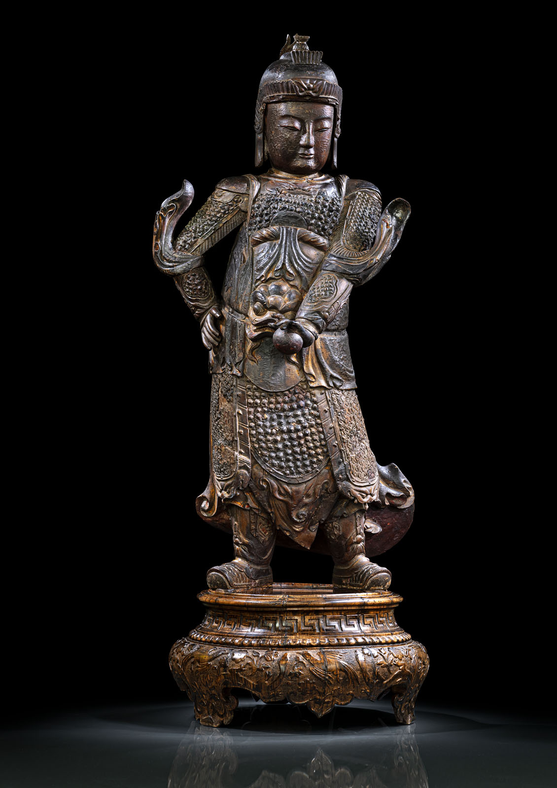 A RARE LARGE GILT- AND RED LACQUERED WOOD FIGURE OF SKANDA