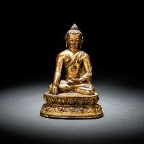 A GILT-BRONZE FIGURE OF BUDDHA SHAKYAMUNI