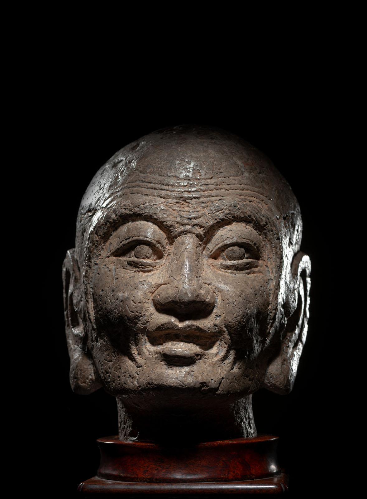 A RARE STONE HEAD OF PROBABLY KASYAPA