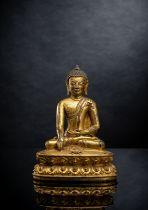 A GILT-BRONZE FIGURE OF BUDDHA AKSHOBYA