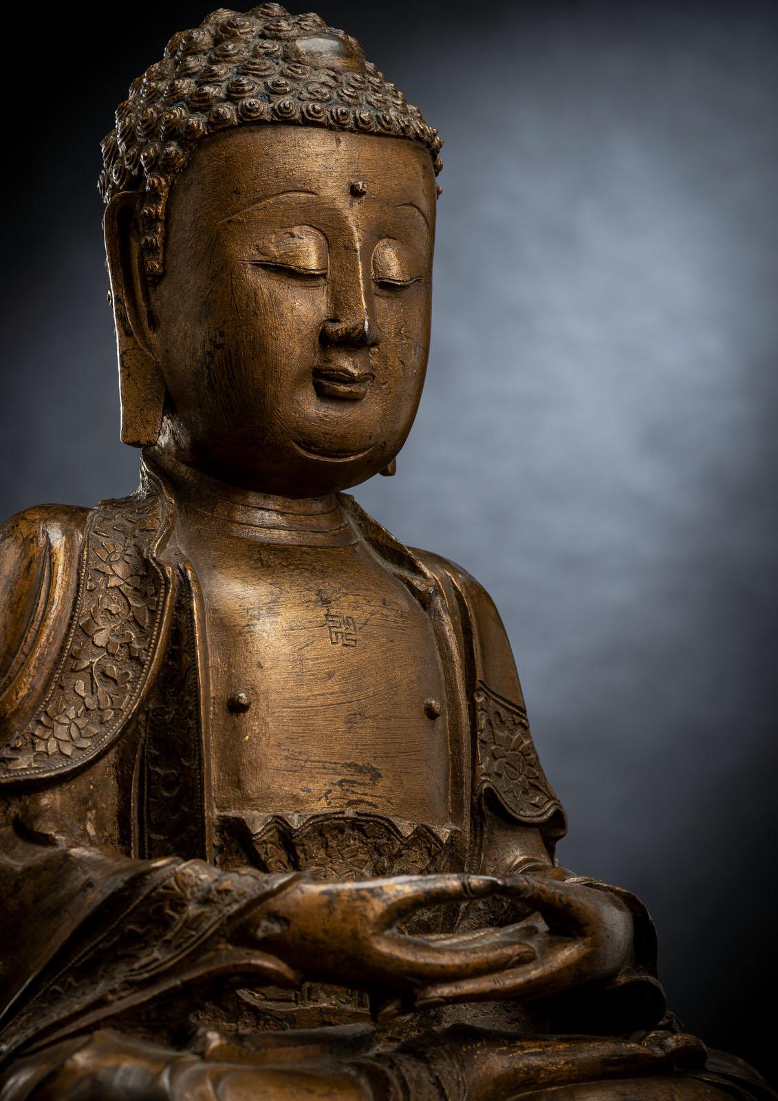 A GILT-LACQUERED BRONZE FIGURE OF BUDDHA SHAKYAMUNI - Image 2 of 2