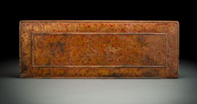 A GILT AND POLYCHROME MANUSCRIPT COVER FROM WOOD WITH TENDRILS AND FLOWERS