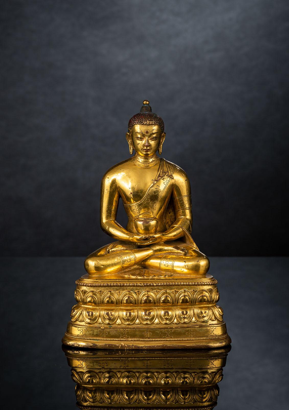 A FINE GILT-BRONZE FIGURE OF BUDDHA SHAKYAMUNI IN ZANABAZAR STYLE