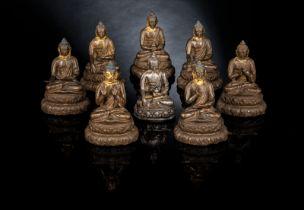 SEVEN BRONZE FIGURES OF THE BHAISAJYAGURU AND A SILVER FIGURE OF BUDDHA SHAKYAMUNI