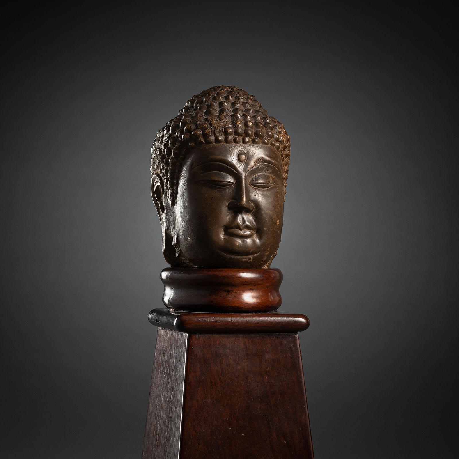 A LIMESTONE HEAD OF BUDDHA SHAKYAMUNI