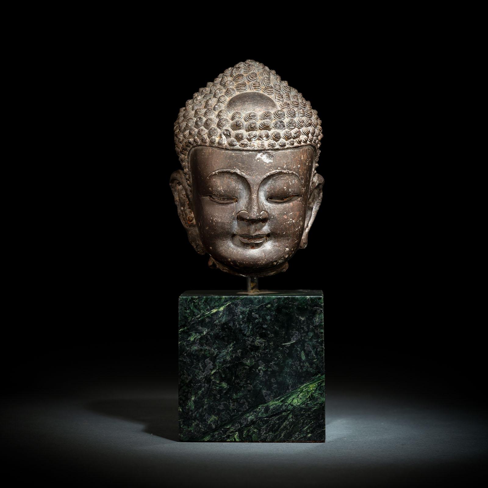 A FINE CARVED GREY-BROWN CARVED STONE HEAD OF BUDDHA SHAKYAMUNI