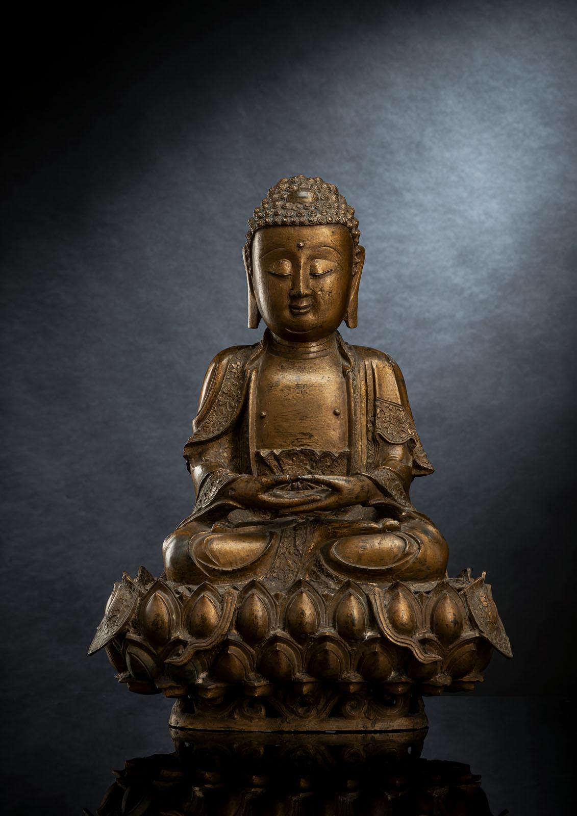 A GILT-LACQUERED BRONZE FIGURE OF BUDDHA SHAKYAMUNI