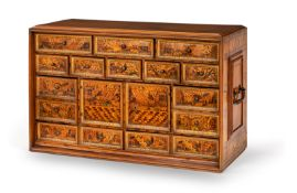 A FINE SOUTH GERMAN PARCEL GILT FRUITWOOD, ASH, SYCAMORE AND MARQUETRY CABINET