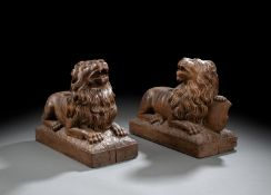 A PAIR OF DECORATIVE CARVED OAKWOOD LIONS
