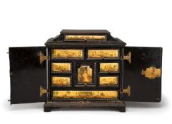 A SOUTH GERMAN EBONIZED AND POLYCHROME PAINTED TABLE CABINET