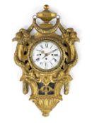 A GILTWOOD LOUIS XVI CARTEL WALL CLOCK