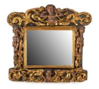 A NORTH ITALIAN POLYCHROME AND GILT CARVED WOOD MIRROR