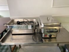 A pair of chafing dishes