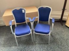 A quantity of Burgess stacking conference room chairs with arms