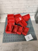 Wall rack with red bin holders storage